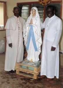 The late Bishop James Owusu receiving Our Lady of Lourdes statue for Techiman Grotto Ghana.